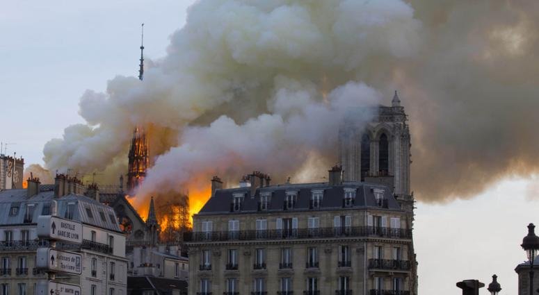 The roof of Notre Dame Cathedral is on fire.
