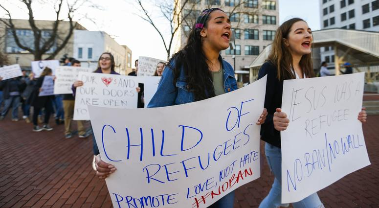 Jan 30, 2017; Springfield, Missouri; Leila Ismaio (left) and Karina Bratkov lead a group of protestors around the Park Central Square protesting against President Trump's immigration policies.