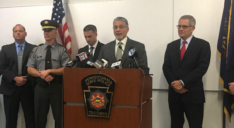 DA Larry Krasner and Pa. State Police at a press conference.