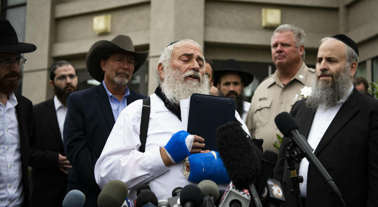 Rabbi Yisroel Goldstein speaks during a press conference in front of Chabad of Poway synagogue.