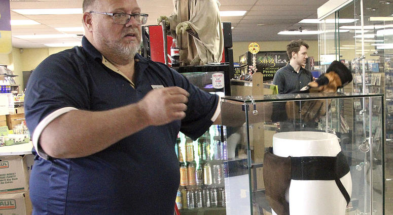 "In this May 2, 2018 file photo, Blockbuster Alaska general manager Kevin Daymude moves a display case featuring the jockstrap worn by actor Russell Crowe in the 2005 movie ""Cinderella Man"" at a Blockbuster video store in Anchorage, Alaska."