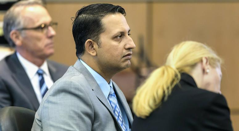 Nouman Raja sits between defense attorney Scott Richardson, left, and paralegal Debi Stratton as attorney Richard Lubin gives his closing arguments in Raja's trial, Wednesday, March 6, 2019 in West Palm Beach, Fla.