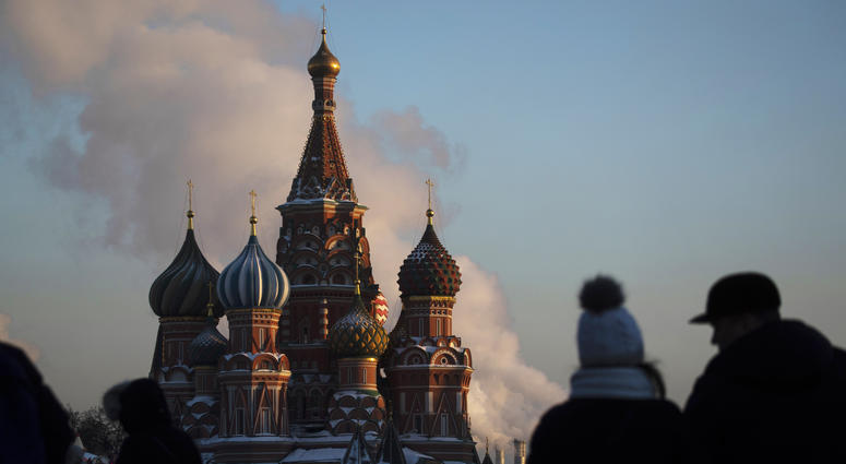 In this Thursday, Jan. 24, 2019 file photo, people walk in Red Square on a cold day, with St. Basil's Cathedral in the background, in Moscow, Russia.