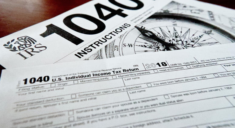 FILE- This Feb. 13, 2019, file photo shows multiple forms printed from the Internal Revenue Service web page that are used for 2018 U.S. federal tax returns in Zelienople, Pa. If you don't think you will be able to complete and file your taxes on time, re