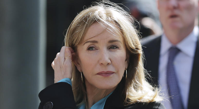 FILE - In this April 3, 2019 file photo, actress Felicity Huffman arrives at federal court in Boston to face charges in a nationwide college admissions bribery scandal.