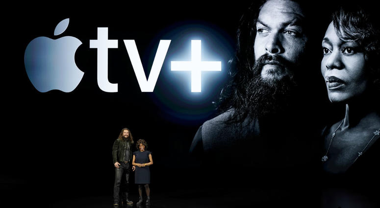 Actors Jason Momoa, left, and Alfre Woodard speak at the Steve Jobs Theater during an event to announce new Apple products Monday, March 25, 2019, in Cupertino, Calif.