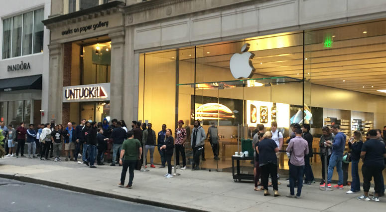 Shoppers line up outside of the Apple store on Walnut Street in Center City Philadelphia.