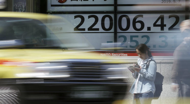 An electronic stock board shows Japan's Nikkei 225 index at a securities firm in Tokyo Tuesday, May 7, 2019.
