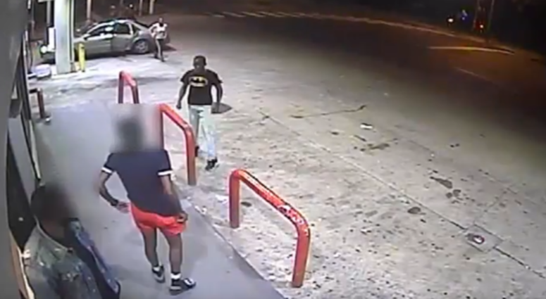 Police are on the hunt for four suspects who shattered a woman's car windows with a baseball bat at a gas station while the 33-year-old woman and her 9-year-old daughter were inside.