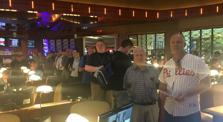 Sports fans wait in line to place bets at Borgata in Atlantic City.