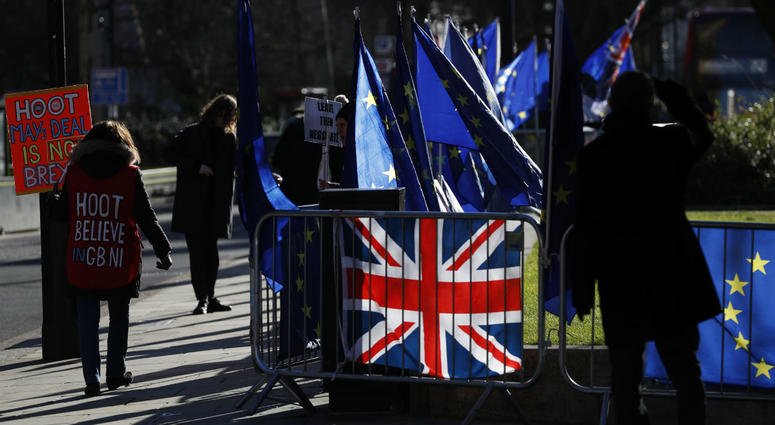 Pro and Anti Brexit protesters demonstrate outside the Houses of Parliament in London, Monday, Jan. 28, 2019.
