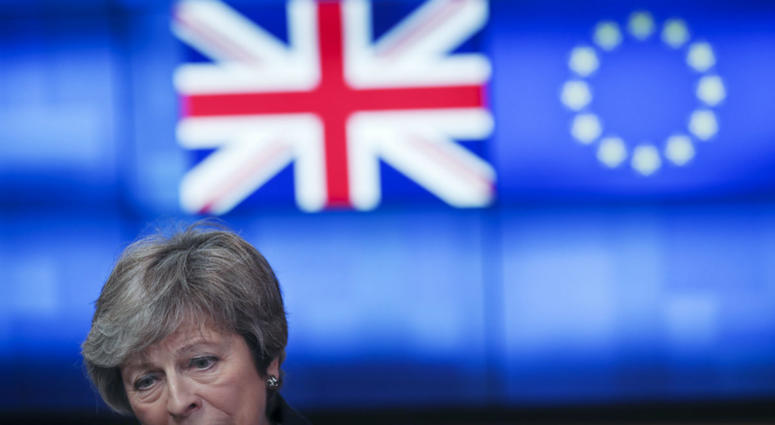 Britain's Prime Minister Theresa May talks to journalists after her meeting with European Council President Donald Tusk at the European Council headquarters in Brussels, Thursday, Feb. 7, 2019.