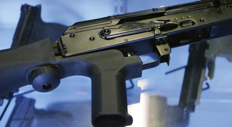 "A ""bump stock"" is attached to a semi-automatic rifle at the Gun Vault store and shooting range in South Jordan, Utah."
