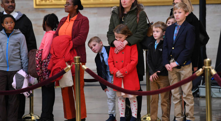 Visitors to the Capitol Rotunda pay respects to President George H.W. Bush as he lies in state at the U.S. Capitol Rotunda.