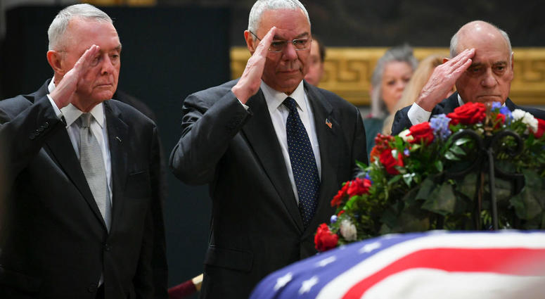 Colin Powell, the 65th United States Secretary of State (2001-2005), who served under President George W. Bush, pays respect to President Bush as he lies in state at the U.S. Capitol Rotunda.