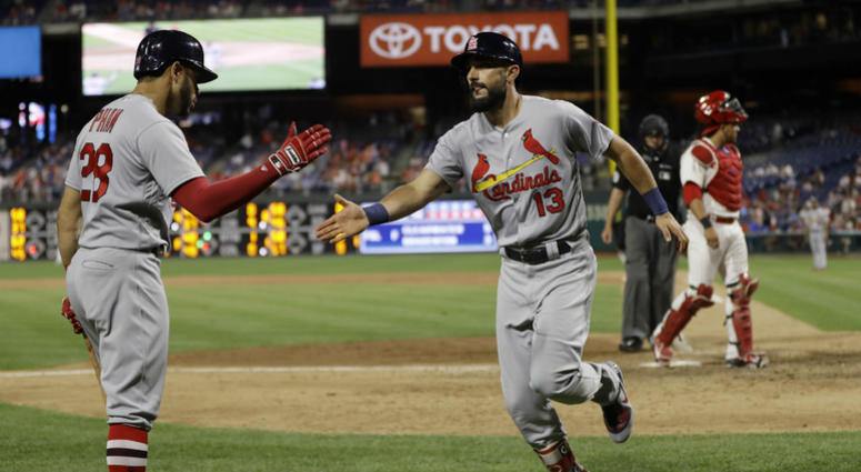 St. Louis Cardinals' Matt Carpenter, center, celebrates with Tommy Pham, left, after Carpenter's go-ahead home run off Philadelphia Phillies relief pitcher Seranthony Dominguez during the ninth inning of a baseball game, June 19, 2018, in Philadelphia.