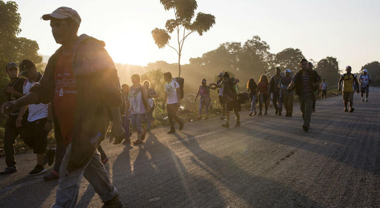 Central American migrants traveling with a caravan to the U.S. make their way to Mapastepec, Mexico, Wednesday, Oct. 24, 2018.