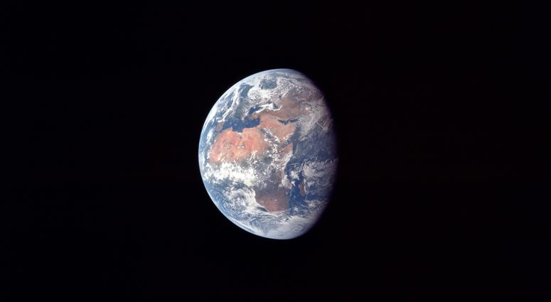 Earth at about 182,500 km or 98,500 nautical miles. North is up and the African continent is prominent. Also visible are Arabia, Asia and Europe, particularly Spain.