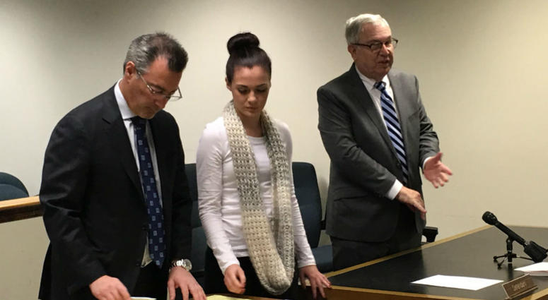 Emily Weinman is shown with her defense lawyers Stephen Sheffler and Stephen Dicht.