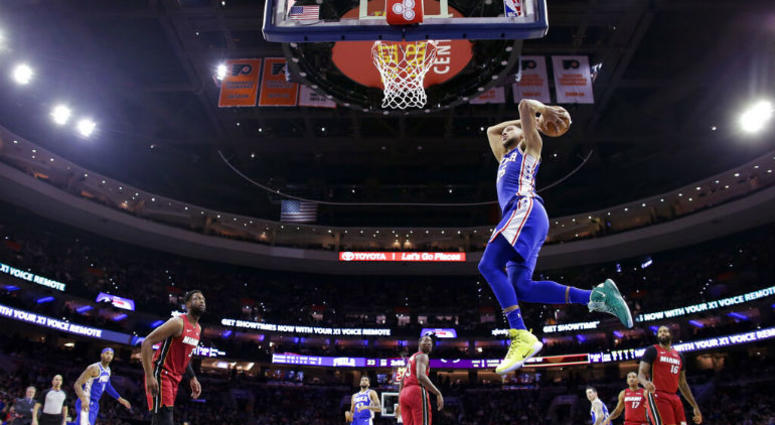 924292adc Philadelphia 76ers  Ben Simmons goes up for a dunk during the first half of  the. Matt Slocum AP Photo