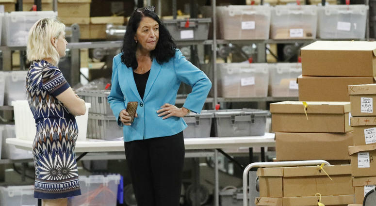 Palm Beach County Supervisor Of Elections Susan Bucher, right, talks to an employee at the Supervisor of Elections office during a recount, Thursday, Nov. 15, 2018, in West Palm Beach, Fla.