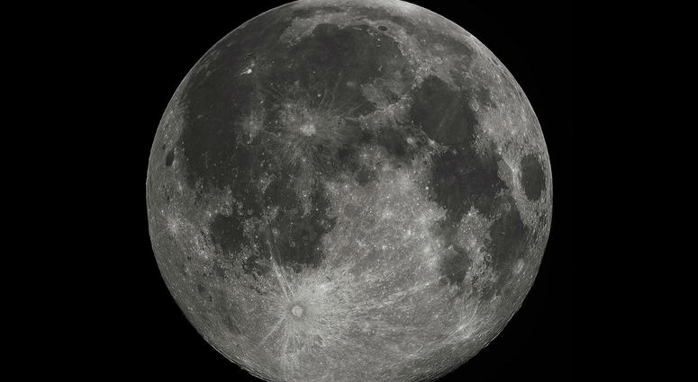 Full Moon in the darkness of the night sky.