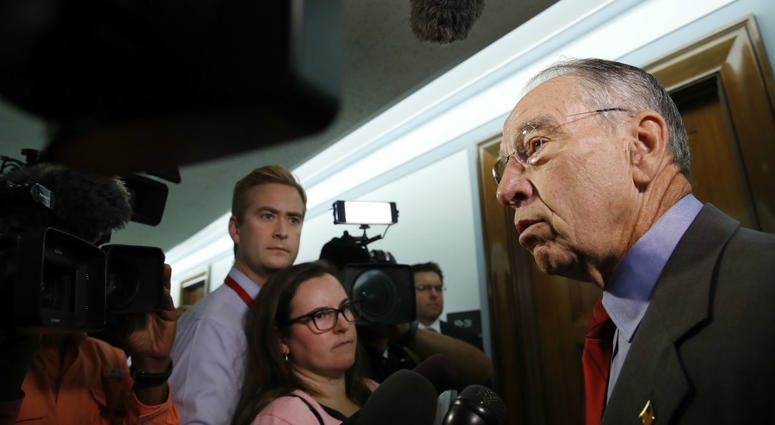 Sen. Chuck Grassley, R-Iowa, right, chair of the Senate Judiciary Committee, answers questions from reporters about allegations of sexual misconduct against Supreme Court nominee Brett Kavanaugh, Wednesday, Sept. 26, 2018.