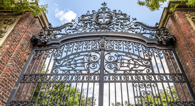 The historic gate of the famous Harvard University in Cambridge, Massachusetts