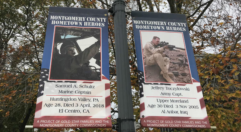 At left is a banner for Capt. Samuel Schultz, joining 17 others dedicated to men and women killed in service since Sept. 11, 2001.