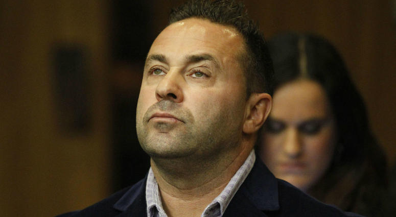 """In this Oct. 15, 2014 file photo, Giuseppe """"Joe"""" Giudice, from the television show """"Real Housewives of New Jersey"""", stands during a hearing in the Passaic County Courthouse in Paterson, N.J."""