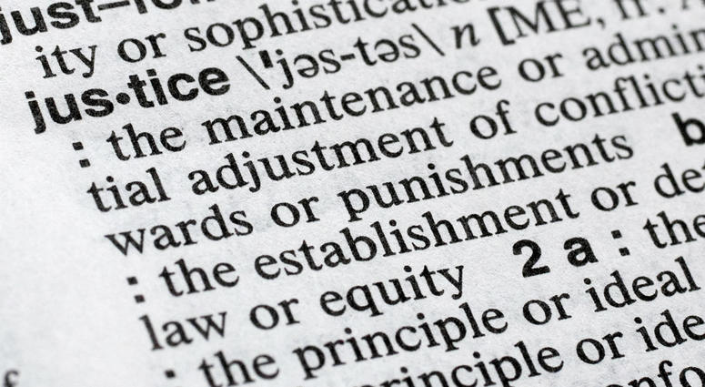 """In this Dec. 12, 2018, photo, """"justice"""" is displayed in a Merriam-Webster dictionary in New York. Merriam-Webster has chosen """"justice"""" as its 2018 word of the year, driven by the churning news cycle and President Trump's Twitter feed."""