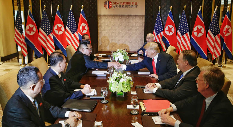 Top leader of the Democratic People's Republic of Korea Kim Jong Un (3rd L) holds talks with U.S. President Donald Trump in Singapore, on June 12, 2018.