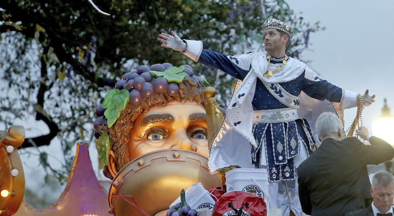 """Bacchus LI, actor Jensen Ackles, throws to the crowd as the 1,600 men of Bacchus present their 32-float Mardi Gras parade entitled """"Starring Louisiana"""" on the Uptown route in New Orleans on Sunday, March 3, 2019."""