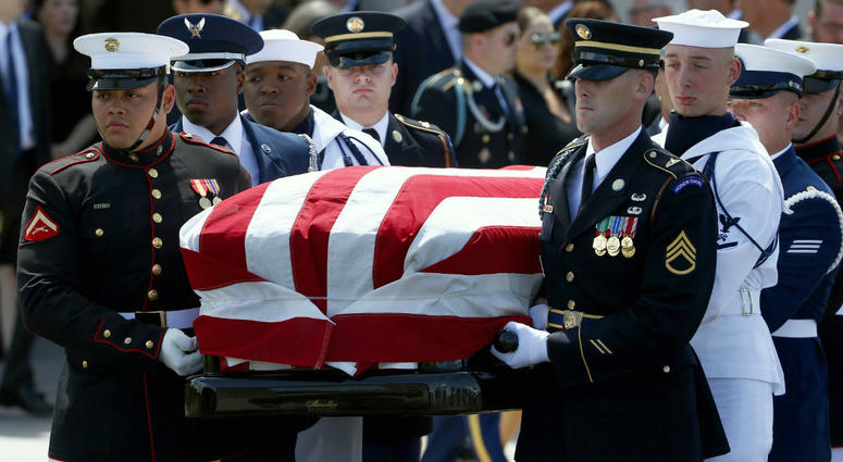 A military honor guard carries the casket of Sen. John McCain, R-Ariz., after a memorial service at North Phoenix Baptist Church Thursday, Aug. 30, 2018, in Phoenix.