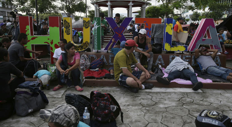 Central American migrants making their way to the U.S. rest in a park after arriving to Huixtla, Mexico, Monday, Oct. 22, 2018.