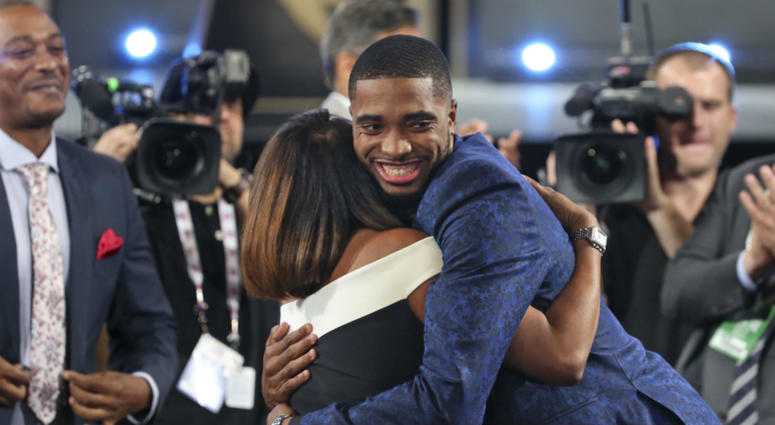 Villanova's Mikal Bridges is greeted by friends and family after he was picked 10th overall by the Philadelphia 76ers during the first round of the NBA basketball draft in New York, Thursday, June 21, 2018.