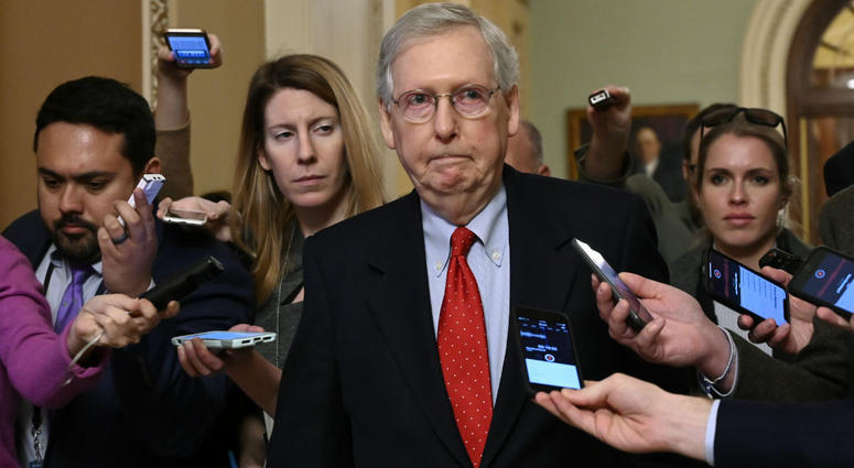 Senate Majority Leader Mitch McConnell of Ky., center, talks with reporters as he walks on Capitol Hill in Washington, Wednesday, Jan. 2, 2019.