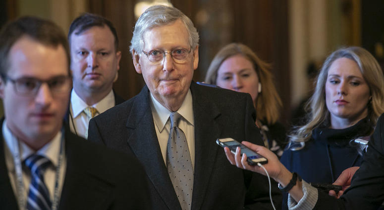 Senate Majority Leader Mitch McConnell, R-Ky., leaves the chamber after speaking about his plan to move a 1,300-page spending measure, which includes $5.7 billion to fund President Donald Trump's proposed wall.