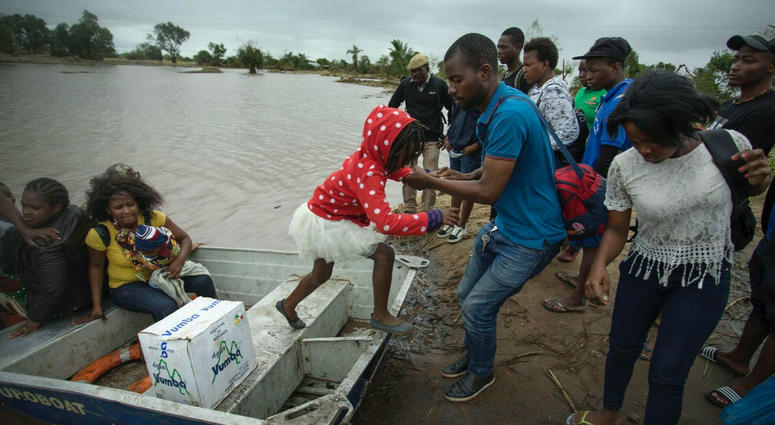 A young girl is helped from a boat after being evacuated from flood waters following cyclone force winds and heavy rain near the coastal city of Beira, Mozambique, Wednesday March 20, 2019.
