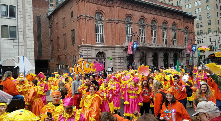 The annual Mummers Parade is in full swing on a surprisingly warm but windy New Year's Day.