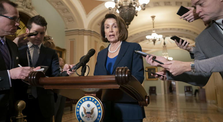 House Democratic Leader Nancy Pelosi of California, the speaker-designate for the new Congress in January, talks to reporters.