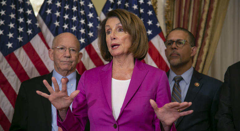 Speaker of the House Nancy Pelosi, D-Calif., flanked by Rep. Peter DeFazio, D-Ore., left, and Rep. Anthony Brown, D-Md., talks to reporters.