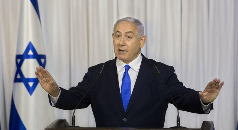 In this Thursday, Feb. 21, 2019 file photo, Israeli Prime Minister Benjamin Netanyahu delivers a statement in Ramat Gan, Israel.