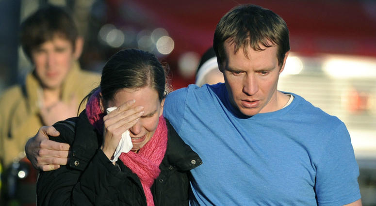 In this Dec. 14, 2012 file photo, Alissa Parker grieves with her husband, Robbie, as they leave a staging area after receiving word that their daughter, Emilie, was one of the 20 children killed in the Sandy Hook School shooting in Newtown, Conn.