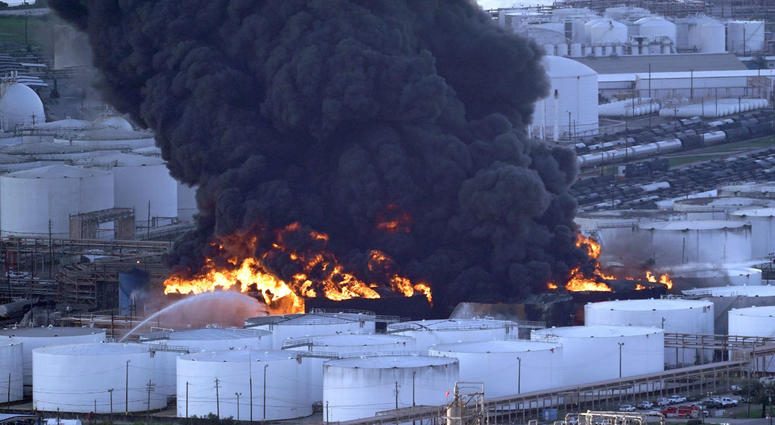 Firefighters battle a petrochemical fire at the Intercontinental Terminals Company Monday, March 18, 2019, in Deer Park, Texas.