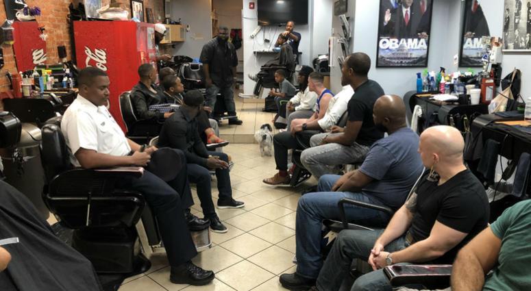 Philadelphia police officers met with community members at a barbershop in West Philly.