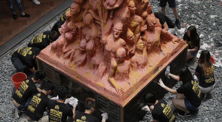 "University of Hong Kong students clean the ""Pillar of Shame"" statue"
