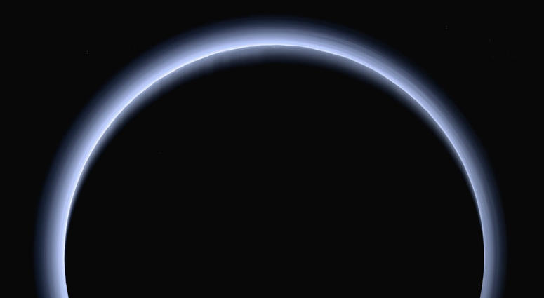 This image made available by NASA in March 2017 shows Pluto illuminated from behind by the sun as the New Horizons spacecraft travels away from it at a distance of about 120,000 miles (200,000 kilometers).
