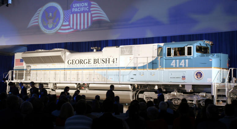 In this Oct. 18, 2005, file photo, a new locomotive numbered 4141 in honor of the 41st president, George H.W. Bush, is unveiled at Texas A&M University in College Station, Texas.