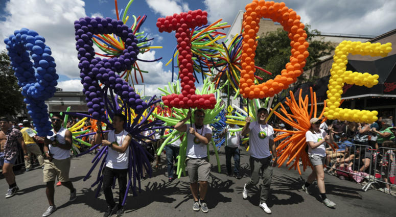 "Marchers hold letters spelling out ""PRIDE"" in balloons during the 48th annual Chicago Pride Parade in Chicago, Ill. on Sunday, June 25, 2017."